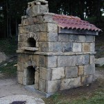 Stone outer walls on garden pizza oven.