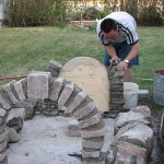 Building walls with re-used cut field stone.