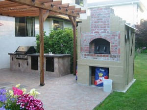 Brick wood fired oven in a kitchen outdoors.