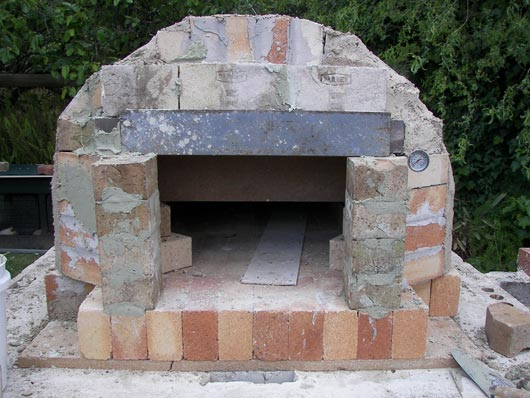 Pizza Oven And Grill Combination In Outdoor Kitchen