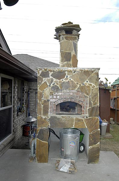 Pizza oven with outside slate stone decorations.
