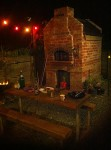 Brick oven with colorful lights at night.
