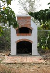 Pizza oven with fruit trees around in Caribbean Anguilla