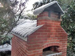 Snow on cottage oven