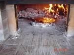 Cooking lasagna in wood burning ovens