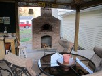Oven built high above ground with wood deck level