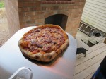 Pizzas cooking and roasting on the wooden floor deck