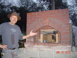 Wood burning oven under roof cover built by Paul