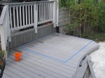 Marking lines for cutting wood deck floor for concrete slab