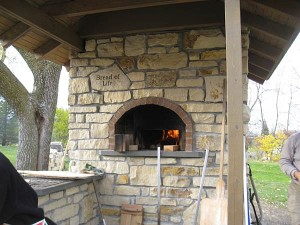 Community oven with natural stone walls. Building was supervised by Mike from Minnesota.