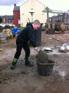 Mixing concrete, helping.