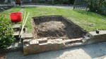 Making the slab behind a retaining wall