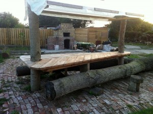 Table with chairs from felled tree