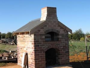 Female builder used recycled house bricks