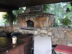Flagstone glued on cinder block oven.