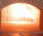 The gas burner flame in brick pizza oven.