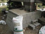Pouring in loose vermiculite insulation matter.