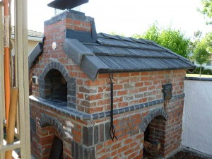 Wood and gas fuel fired brick pizza oven.