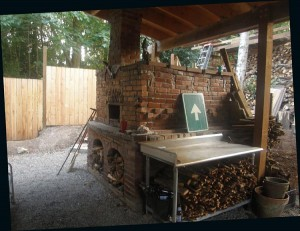 brick oven area roofed and gravel ground