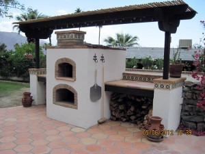 Brick oven with gas fireplace under