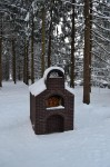 The first snowfall and oven covered under snow.