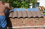 Topping off oven with roof tiles