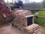 Oven placed on stone base