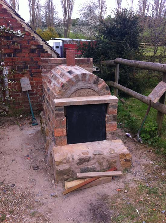 Oven with stone base