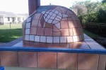 Tiling job on pizza oven sphere shaped