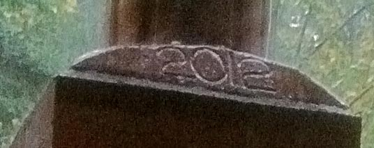 Year date on the top of a chimney masonry work.