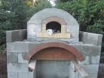 Oven chamber with firebrick which are tapered