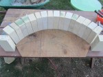 Arch from opposite tapered firebricks