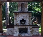 Heat vented into pizza oven from the fireplace below.