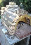 Making the last brick oven arch