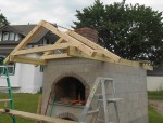 Roof frame for covering oven front