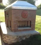 fireplace with oven and smoker