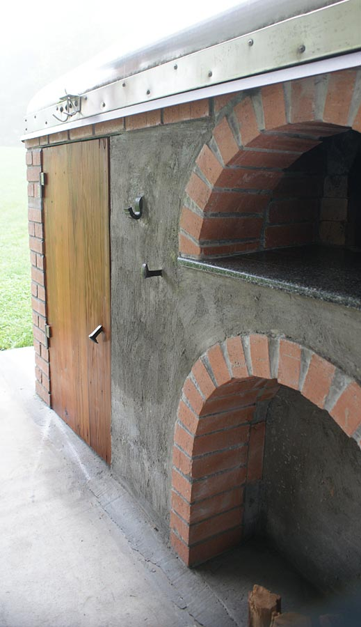 Pizza oven with fireplace and smoker