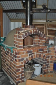Spherical oven with chimney and roof