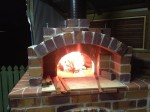 Fire in spherical oven and its front hood