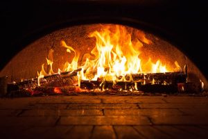 The advantage of using a wood fire pizza ovens