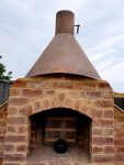 Artistic chimney worked from metal and bricks.